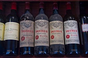 Several vintages of Chateau Petrus at a wine shop